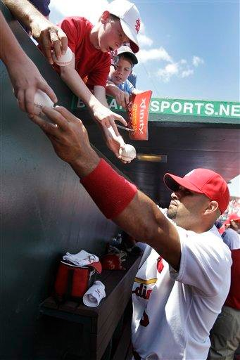 St. Louis Cardinals first baseman Albert Pujols signs autographs before a spring training baseball game against the Atlanta Braves, Monday, March 14, 2011, in Jupiter, Fla. (AP Photo/Carlos Osorio) By Carlos Osorio