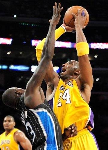 Los Angeles Lakers guard Kobe Bryant (24) drives on Orlando Magic guard Jason Richardson, left, in the first half of an NBA basketball game, Monday, March 14, 2011, in Los Angeles. (AP Photo/Gus Ruelas) By Gus Ruelas