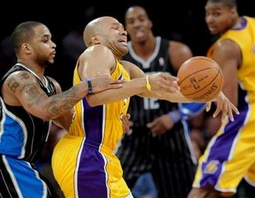 Orlando Magic guard Jameer Nelson, left, fouls Los Angeles Lakers guard Derek Fisher, right, in the first half of an NBA basketball game, Monday, March 14, 2011, in Los Angeles. (AP Photo/Gus Ruelas) By Gus Ruelas