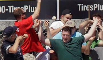 Baseball fans react as a foul ball flies into the stands during a spring training baseball game between the Atlanta Braves and the St. Louis Cardinals, Monday, March 14, 2011, in Jupiter, Fla. (AP Photo/Carlos Osorio) By Carlos Osorio