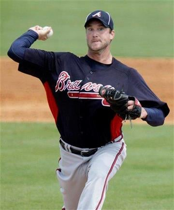Atlanta Braves starting pitcher Derek Lowe (32) throws during the second inning of a spring training baseball game against the St. Louis Cardinals, Tuesday, March 15, 2011, in Jupiter, Fla. (AP Photo) By KMOV Web Producer