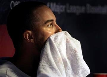 St. Louis Cardinals starting pitcher Adam Wainwright watches the action from the bench after struggling, in the fourth inning of a baseball game against the Chicago Cubs, Tuesday, Sept. 14, 2010 in St. Louis.(AP Photo/Tom Gannam) By Tom Gannam