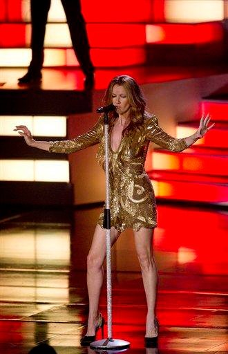 Celine Dion sings her last number during her opening night performance at Caesar's Palace, Tuesday, March 15, 2011, in Las Vegas. (AP Photo/Julie Jacobson) By Julie Jacobson