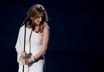 Celine Dion reacts to the audience during her opening night performance at Caesar's Palace, Tuesday, March 15, 2011, in Las Vegas. (AP Photo/Julie Jacobson) By Julie Jacobson