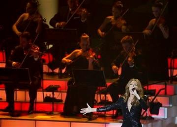 Celine Dion sings a montage from James Bond movies during her opening night performance at Caesar's Palace, Tuesday, March 15, 2011, in Las Vegas. (AP Photo/Julie Jacobson) By Julie Jacobson