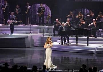 Celine Dion performs during her opening night at Caesar's Palace, Tuesday, March 15, 2011, in Las Vegas. (AP Photo/Julie Jacobson) By Julie Jacobson