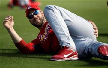 St. Louis Cardinals starting pitcher Chris Carpenter stretches out during spring training baseball Monday, Feb. 14, 2011, in Jupiter, Fla. (AP Photo/Jeff Roberson) By Jeff Roberson