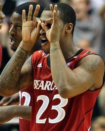 Cincinnati's Sean Kilpatrick celebrates with his teamates Rashad Bishop,left, after hitting a three point shot, during the second half of an NCAA college basketball game on Saturday,March. 5, 2011. (Ap Photo/Tony Tribble) By Tony Tribble