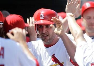 St. Louis Cardinals' Lance Berkman is greeted by teammates after scoring during the sixth inning of a spring training baseball game against the Atlanta Braves, Tuesday, March 15, 2011, in Jupiter, Fla. (AP Photo) By KMOV Web Producer