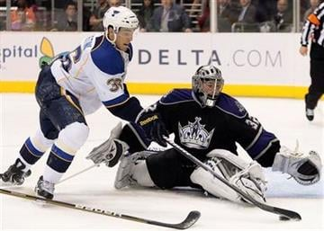 St. Louis Blues right wing Matt D'Agostini, left, tries to score on Los Angeles Kings goalie Jonathan Quick during the first period of an NHL hockey game Thursday, March 17, 2011, in Los Angeles. (AP Photo/Jason Redmond) By Jason Redmond