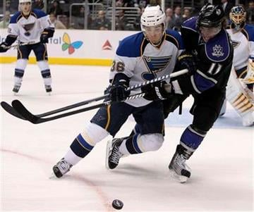 St. Louis Blues right wing Matt D'Agostini, left, and Los Angeles Kings center Anze Kopitar of Slovenia vie for the puck during the second period of an NHL hockey game, Thursday, March 17, 2011, in Los Angeles. (AP Photo/Jason Redmond) By Jason Redmond