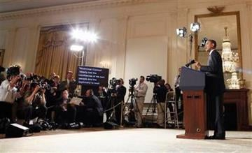 President Barack Obama makes a statement on Libya, Friday, March 18, 2011, in the East Room of the White House in Washington. (AP Photo) By Lakisha Jackson