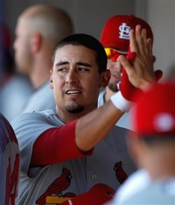 St. Louis Cardinals' Allen Craig is high-fived by teammates after scoring in the second inning of a spring training baseball game against the Washington Nationals, Friday, March 18, 2011, in Viera, Fla. (AP Photo/David Goldman) By David Goldman