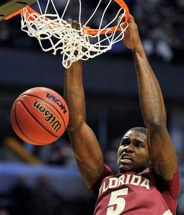 Florida State's Bernard James (5) slam dunks against Texas A&M in the second half of a second-round NCAA Southwest Regional tournament college basketball game in Chicago, Friday, March 18, 2011. (AP Photo/Jim Prisching) By Jim Prisching