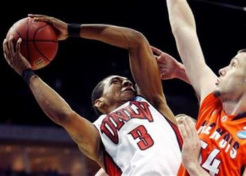 UNLV's Anthony Marshall shoots as Illinois' Mike Tisdale defends in the second half of a Southwest Regional NCAA tournament second round college basketball game, Friday, March 18, 2011 in Tulsa, Okla. (AP Photo) By J. Scott Applewhite - AP