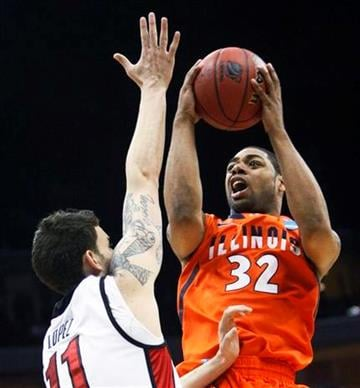 Illinois guard Demetri McCamey shoots over UNLV forward Carlos Lopez in the first half of a Southwest Regional NCAA tournament second round college basketball game, Friday, March 18, 2011 in Tulsa, Okla. (AP Photo/) By J. Scott Applewhite - AP