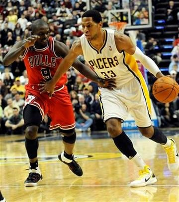 Indiana Pacers forward Danny Granger, right, drives on Chicago Bulls forward Luoi Deng in the second half of an NBA basketball game in Indianapolis, Friday, March 18, 2011. Indiana won 115-108 in overtime. (AP Photo/Tom Strickland) By Tom Strickland
