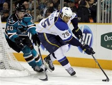 St. Louis Blues' Ryan Reaves, right, skates for the puck ahead of San Jose Sharks' Jason Demers (60) during the first period of an NHL hockey game Saturday, March 19, 2011, in San Jose, Calif. (AP Photo/Ben Margot) By Ben Margot