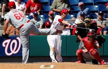Washington Nationals' Adam LaRoche, right, singles off a pitch by St. Louis Cardinals' Blake King (66) in the fifth inning of a spring training baseball game Friday, March 18, 2011 in Viera, Fla. (AP Photo/David Goldman) By David Goldman