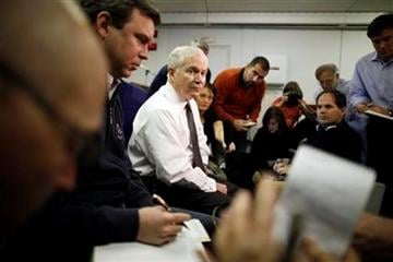 U.S. Defense Secretary Robert Gates speaks about Libya as he briefs reporters on board a military plane en route to St. Petersburg, Russia, Sunday, March 20, 2011. (AP Photo/Charles Dharapak, Pool) By Charles Dharapak