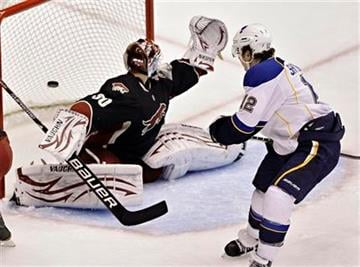 St. Louis Blues' Kevin Shattenkirk (12) scores a goal past Phoenix Coyotes goalie Ilya Bryzgalov, of Russia, during the first period of an NHL hockey game Tuesday, March 22, 2011, in Glendale, Ariz. (AP Photo/Matt York) By Matt York