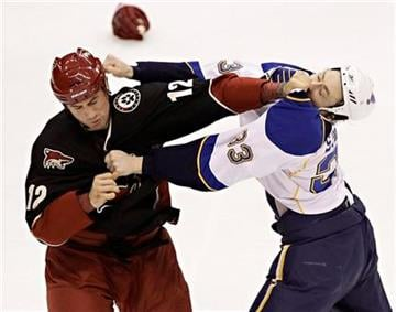Phoenix Coyotes Paul Bissonnette (12) fights St. Louis Blues' Tyson Strachan (33) during the second period of an NHL hockey game Tuesday, March 22, 2011, in Glendale, Ariz. (AP Photo/Matt York) By Matt York