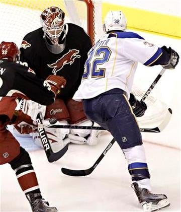 Phoenix Coyotes goalie Ilya Bryzgalov, of Russia, blocks a shot by St. Louis Blues' Chris Porter (32) during the second period of an NHL hockey game Tuesday, March 22, 2011, in Glendale, Ariz. (AP Photo/Matt York) By Matt York