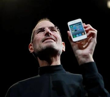 Apple CEO Steve Jobs holds the new iPhone 4 at the Apple Worldwide Developers Conference, Monday, June 7, 2010, in San Francisco. (AP Photo/Paul Sakuma) By Paul Sakuma