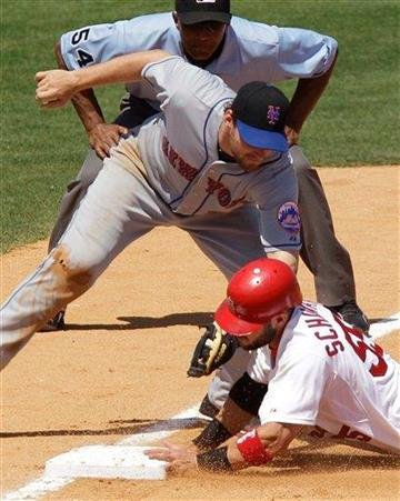St. Louis Cardinals' Skip Schumaker is caught stealing third base by New York Mets third baseman Daniel Murphy during the fifth inning of a spring training baseball game Wednesday, March 23, 2011, in Jupiter, Fla. (AP Photo/Carlos Osorio) By Carlos Osorio