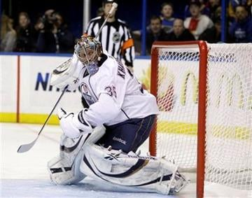 Edmonton Oilers goalie Nikolai Khabibulin (35) watches a a shot sails just wide of the goal in the second period of an NHL hockey game against the St. Louis Blues, Thursday, March 24, 2011 in St. Louis.(AP Photo/Tom Gannam) By Tom Gannam