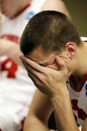 Wisconsin's Ben Brust react by his locker after the NCAA Southeast regional college basketball semifinal game against Florida Thursday, March 24, 2011, in New Orleans. Butler won 61-54. (AP Photo/David J. Phillip) By David J. Phillip