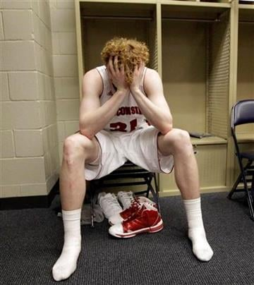 Wisconsin's Mike Bruesewitz sits by his locker after the NCAA Southeast regional college basketball semifinal game against Florida Thursday, March 24, 2011, in New Orleans. Butler won 61-54. (AP Photo/David J. Phillip) By David J. Phillip