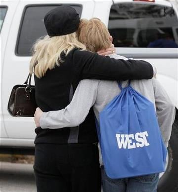 Rhonda Hickey comforts her son Tyler after students were released to parents following an early morning shooting at West Middle School in Martinsville, Ind., Friday, March 25, 2011. (AP Photo/Darron Cummings) By Darron Cummings