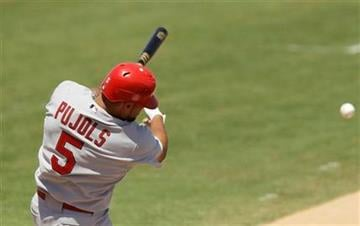 St. Louis Cardinals' Albert Pujols (5) follows through on his home run during the fourth inning of a spring training baseball game against the Florida Marlins, Saturday, March 26, 2011 in Jupiter, Fla. (AP Photo/Carlos Osorio) By Carlos Osorio