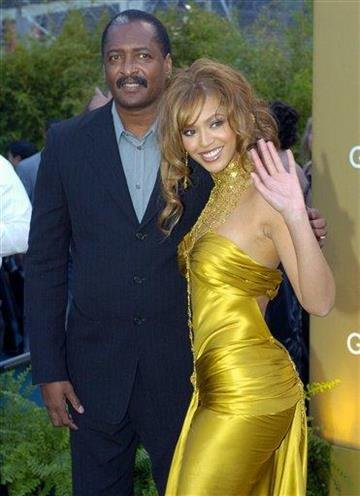 FILE - In this Feb. 8, 2004 file photo, singer Beyonce Knowles arrives at the 46th Annual Grammy Awards with her father and manager Mathew Knowles in Los Angeles. (AP Photo/Mark J. Terrill, file) By MARK J. TERRILL