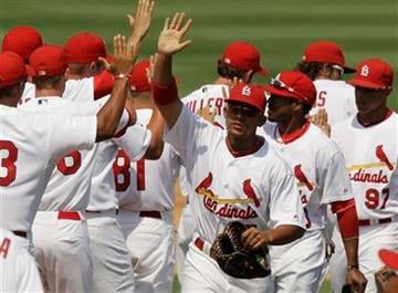 The St. Louis Cardinals celebrate their 3-1 win over the New York Mets after a spring training baseball game, Sunday, March 27, 2011, in Jupiter, Fla. (AP Photo/Carlos Osorio) By Carlos Osorio