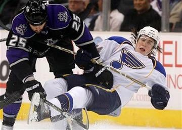 St. Louis Blues center T.J. Oshie, right, gets upended by Los Angeles Kings right wing Dustin Penner during the second period of an NHL hockey game Thursday, March 17, 2011, in Los Angeles. (AP Photo/Jason Redmond) By Jason Redmond