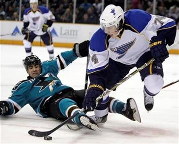 St. Louis Blues' TJ Oshie, right, takes control of the puck as San Jose Sharks' Jamal Mayers falls to the ice during the second period of an NHL hockey game Saturday, March 19, 2011, in San Jose, Calif. (AP Photo/Ben Margot) By Ben Margot