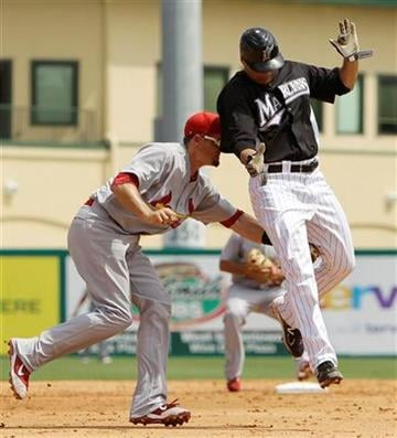 St. Louis Cardinals third baseman David Freese tags out Florida Marlins' Javier Vazquez on his way to third during the sixth inning of a spring training baseball game, Tuesday, March 29, 2011 in Jupiter, Fla. (AP Photo/Carlos Osorio) By Carlos Osorio