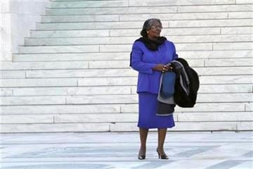 Plaintiff Betty Dukes stands outside the Supreme Court in Washington, Tuesday, March 29, 2011, prior to attending a case of women employees against Wal-Mart. (AP Photo/Jacquelyn Martin) By Jacquelyn Martin
