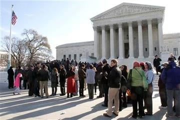 People line up outside the Supreme Court in Washington, Tuesday, March 29, 2011, to attend a hearing on women employees against Wal-Mart. (AP Photo/Jacquelyn Martin) By Jacquelyn Martin