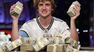 Ryan Riess holds up two bricks of $100 bills after winning World Series of Poker Final Table on Nov. 5, 2013, in Las Vegas, defeating runner-up Jay Farber for $8.4 million payout By Brendan Marks