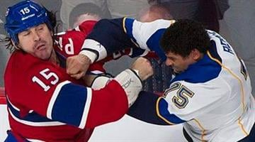 Montreal Canadiens' George Parros, left, fights with St. Louis Blues' Ryan Reaves during the first period of an NHL hockey game in Montreal, Tuesday, Nov. 5, 2013. (AP Photo/The Canadian Press, Graham Hughes) By Graham Hughes