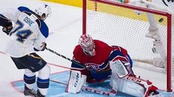 St. Louis Blues' T.J. Oshie scores on Montreal Canadiens goalie Carey Price during the shootout in an NHL hockey game in Montreal, Tuesday, Nov. 5, 2013. (AP Photo/The Canadian Press, Graham Hughes) By AP Photo/The Canadian Press