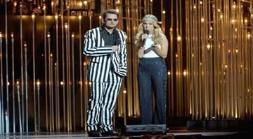 NASHVILLE, TN - NOVEMBER 06: Hosts Brad Paisley (L) and Carrie Underwood speak onstage during the 47th annual CMA awards at the Bridgestone Arena on November 6, 2013 in Nashville, United States. (Photo by Rick Diamond/Getty Images) By Getty Images