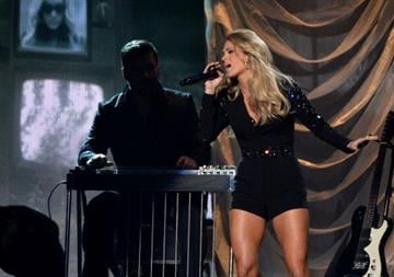 NASHVILLE, TN - NOVEMBER 06:  Carrie Underwood performs onstage during the 47th annual CMA Awards at the Bridgestone Arena on November 6, 2013 in Nashville, Tennessee.  (Photo by Rick Diamond/Getty Images) By Rick Diamond