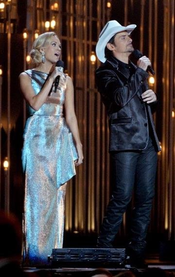 NASHVILLE, TN - NOVEMBER 06:  Hosts Carrie Underwood and Brad Paisley speak onstage during the 47th annual CMA Awards at the Bridgestone Arena on November 6, 2013 in Nashville, Tennessee.  (Photo by Rick Diamond/Getty Images) By Rick Diamond