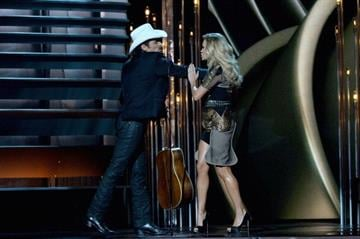 NASHVILLE, TN - NOVEMBER 06:  Hosts Brad Paisley (L) and Carrie Underwood perform onstage during the 47th annual CMA awards at the Bridgestone Arena on November 6, 2013 in Nashville, United States.  (Photo by Rick Diamond/Getty Images) By Rick Diamond