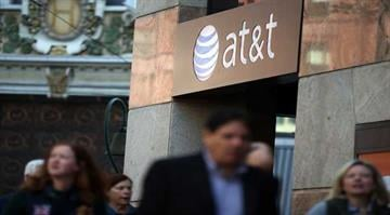 SAN FRANCISCO, CA - OCTOBER 23: Pedestrians walk by an AT&T store on October 23, 2013 in San Francisco, California. By Stephanie Baumer