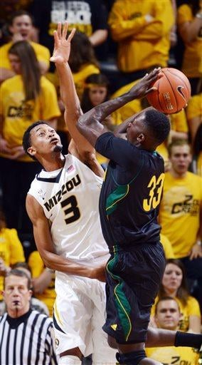 Missouri's Johnathan Williams III, left, tries to block the shot of Southeastern Louisiana's Onochie Ochie, right, during the first half of an NCAA college basketball game Friday, Nov. 8, 2013, in Columbia, Mo. (AP Photo/L.G. Patterson) By L.G. Patterson